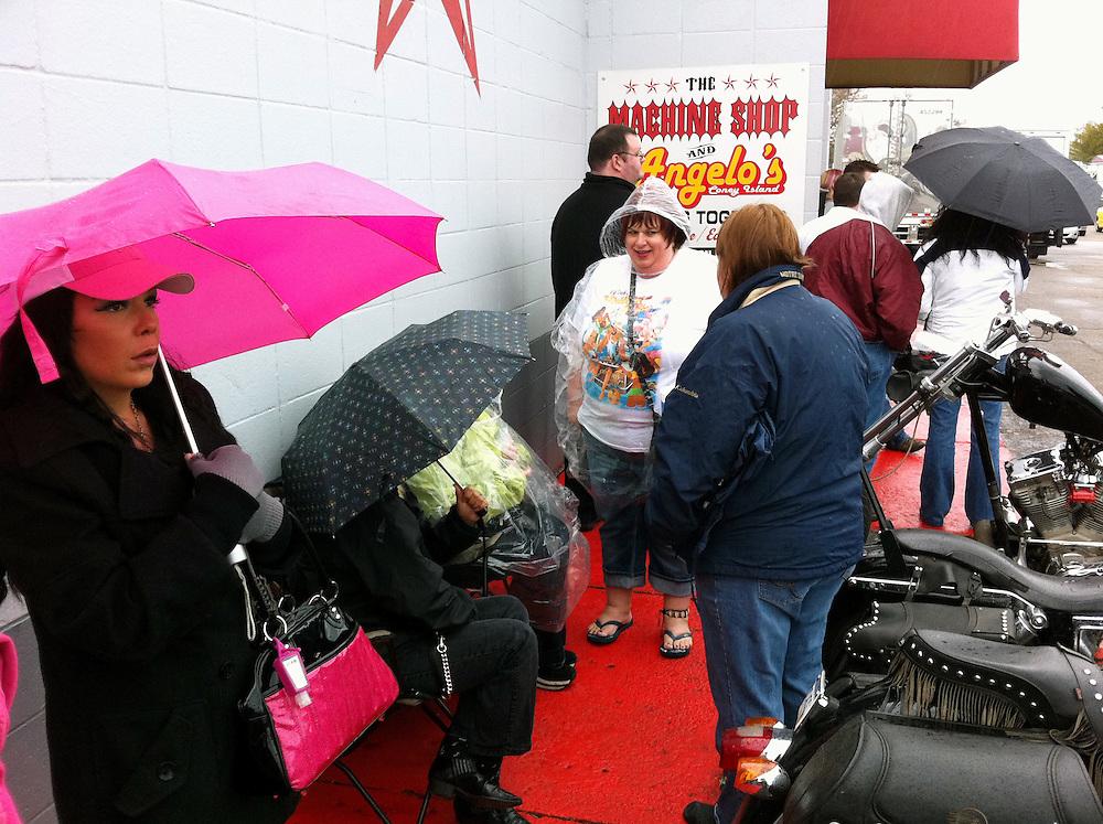 Matt Dixon | The Flint Journal..Ticket holders wait outside The Machine Shop in Flint for an invite-only Kid Rock Show, Saturday evening.