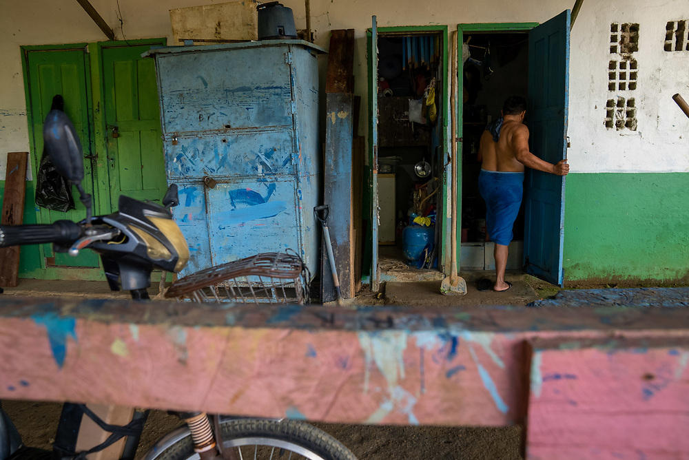 A staff person walks into a room after showering at Nossa Senhora Aparecida public cemetery March 30, 2021 in Manaus, Brazil. Brazilian residences are receiving the CoronaVac vaccine, also known as the Sinovac COVID-19 vaccine. CoronaVac is an inactivated virus COVID-19 vaccine developed by the Chinese company Sinovac Biotech and has been in Brazil's Phase III clinical trials. Photo Ken Cedeno