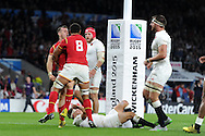 Gareth Davies of Wales celebrates with teammate Taulupe Faletau (8) after he scores his sides late try.Rugby World Cup 2015 pool A match, England v Wales at Twickenham Stadium in London, England  on Saturday 26th September 2015.<br /> pic by  Andrew Orchard, Andrew Orchard sports photography.