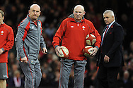 Wales coaches Sean Edwards (l), Neil Jenkins © and head coach Warren Gatland look on before k/o. Autumn International rugby, 2013 Dove men series, Wales v South Africa at the Millennium Stadium in Cardiff,  South Wales on Saturday 9th November 2013. pic by Andrew Orchard, Andrew Orchard sports photography,