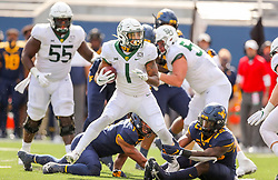 Oct 3, 2020; Morgantown, West Virginia, USA; Baylor Bears running back Trestan Ebner (1) spins away from a tackle during the fourth quarter against the West Virginia Mountaineers at Mountaineer Field at Milan Puskar Stadium. Mandatory Credit: Ben Queen-USA TODAY Sports