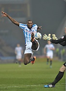 Ishmael Miller of Huddersfield Town beats John Ruddy goalkeeper of Norwich City to the ball during the Sky Bet Championship match at the John Smiths Stadium, Huddersfield<br /> Picture by Graham Crowther/Focus Images Ltd +44 7763 140036<br /> 17/03/2015