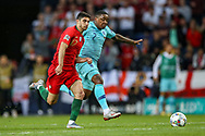 Portugal midfielder Conclamo Guedes (17) battles with Netherlands forward Steven Bergwijn (PSV Eindhoven)  during the UEFA Nations League match between Portugal and Netherlands at Estadio do Dragao, Porto, Portugal on 9 June 2019.