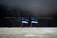Tallinn, Estonia - February 23, 2020: Estonian flags at the Memorial to the Victims of Communism, which was established in 2018. During the Soviet period, more than 75,000 people from Estonia were murdered, imprisoned or deported.