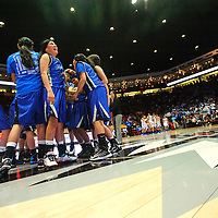 031513  Adron Gardner/Independent<br /> <br /> The Navajo Pine Warriors assemble at half-court after beating the Laguna Acoma Hawks for the 2A state title at The Pit in Albquerque.