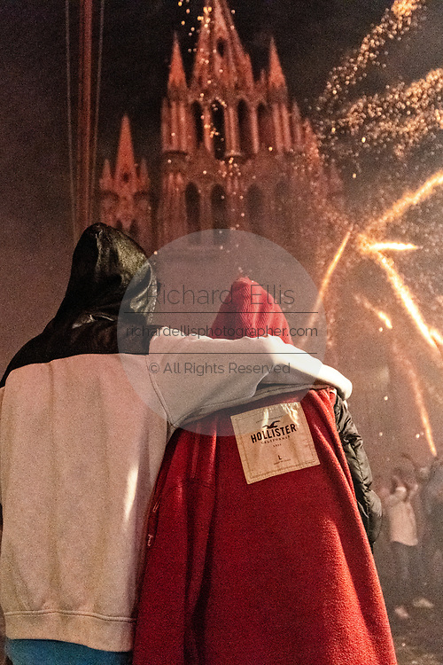 A couple embrace as they watch sky rockets explode around them in front of the San Miguel Archangel church during the Alborada festival September 29, 2018 in San Miguel de Allende, Mexico. The unusual festival celebrates the cities patron saint with a two hour-long firework battle at 4am representing the struggle between Saint Michael and Lucifer.