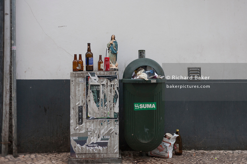 In a quirky scene of religious morality and a Christian lifestyle, a figure of Jesus stands surrounded by the bottles of an alcoholic night for others, on 18th July, at Aveira, Portugal. The World Health Organisation has called on governments to do more to prevent alcohol-related deaths and diseases as it released its Global Status Report on Alcohol and Health 2014 earlier this week, which found alcohol consumption in Portugal is still above the European average. 18 is the legal age for the purchase of alcohol in Portugal. (Photo by Richard Baker / In Pictures via Getty Images)