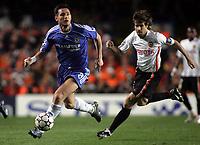 Photo: Paul Thomas.<br /> Chelsea v Valencia. UEFA Champions League. Quarter Final, 1st Leg. 04/04/2007.<br /> <br /> Frank Lampard (L) of Chelsea gets away from David Abelda.