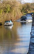 Land Rover Discovery Td5 vehicle driving through flood water at Kellaways, Wiltshire, England, UK 24/12/20