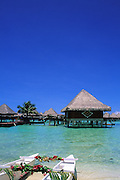 Image of the beach and overwater bungalows on Bora Bora, Tahiti, French Polynesia by Andrea Wells