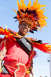 London, August 27 2017. A young reveller awaits the start of the procession as Family Day of the Notting Hill Carnival gets underway. The Notting Hill Carnival is Europe's biggest street party held over two days of the bank holiday weekend, attracting over a million people. © Paul Davey.