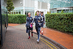 CARDIFF, WALES - Tuesday, October 7, 2014: Wales' Jonathan Williams and Ben Davies depart the team hotel for a training session at Dragon Park National Football Development Centre ahead of the UEFA Euro 2016 qualifying match against Bosnia and Herzegovina. (Pic by David Rawcliffe/Propaganda)