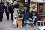As Londoners from the mainly Asian community await the second coronavirus national lockdown it's business as usual at Bethnal Green Road Market with people out and about, some wearing face masks and some not, on what will be the last few days of normality before a month-long total lockdown in the UK on 2nd November 2020 in London, United Kingdom. The three tier system in the UK has not worked sufficiently, to suppress the virus, and there have have been calls by politicians for a 'circuit breaker' complete lockdown to be announced to help the growing spread of the Covid-19.