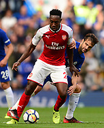 Danny Welbeck of Arsenal battles with Cesc Fabregas of Chelsea ®. Premier league match, Chelsea v Arsenal at Stamford Bridge in London on Sunday 17th September 2017.<br /> pic by Andrew Orchard sports photography.