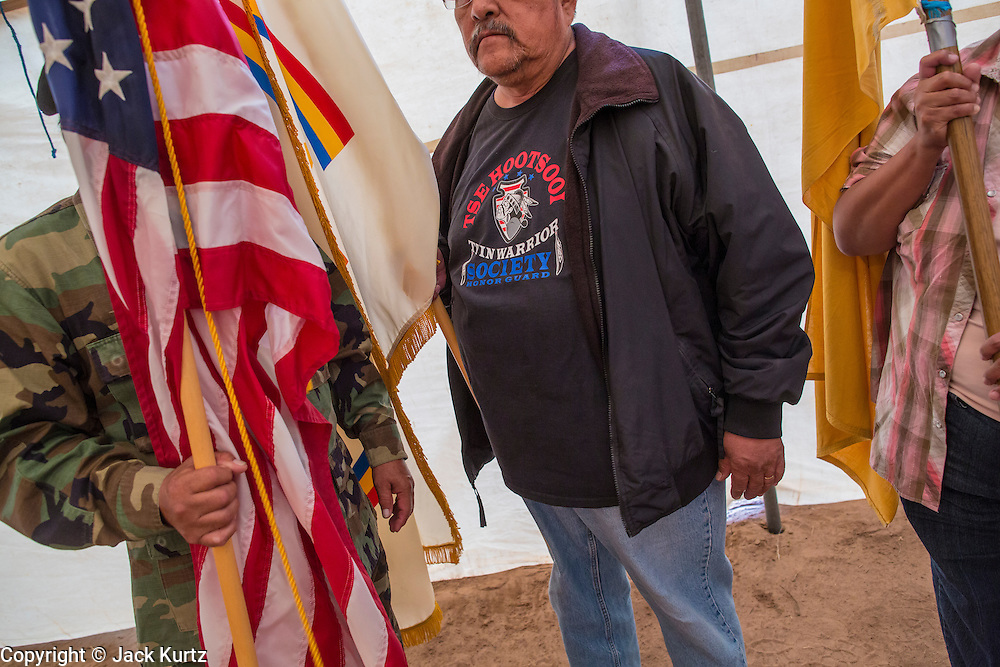 """13 JULY 2012 - FT DEFIANCE, AZ: Veterans present the American flag during a special veterans' service at the 23rd annual Navajo Nation Camp Meeting in Ft. Defiance, north of Window Rock, AZ, on the Navajo reservation. Preachers from across the Navajo Nation, and the western US, come to Navajo Nation Camp Meeting to preach an evangelical form of Christianity. Evangelical Christians make up a growing part of the reservation - there are now more than a hundred camp meetings and tent revivals on the reservation every year. The camp meeting in Ft. Defiance draws nearly 200 people each night of its six day run. Many of the attendees convert to evangelical Christianity from traditional Navajo beliefs, Catholicism or Mormonism. """"Camp meetings"""" are a form of Protestant Christian religious services originating in Britain and once common in rural parts of the United States. People would travel a great distance to a particular site to camp out, listen to itinerant preachers, and pray. This suited the rural life, before cars and highways were common, because rural areas often lacked traditional churches. PHOTO BY JACK KURTZ"""