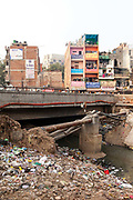 A new road that was being built over an open sewer, Malviya Nagar, New Delhi, India