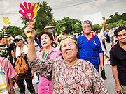 05 AUGUST 2013 - BANGKOK, THAILAND: An anti-government protestor uses her clapper during an anti-government protest in Bangkok. About 500 people, members of the  People's Army against Thaksin Regime, a new anti-government group, protested in Lumpini Park in central Bangkok. The protest was peaceful but more militant protests are expected later in the week when the Parliament is expected to debate an amnesty bill which could allow Thaksin Shinawatra, the exiled former Prime Minister, to return to Thailand.    PHOTO BY JACK KURTZ