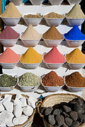 Bowls of colorful Egyptian spices displayed at a spice bazaar in Cairo