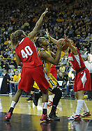 January 08 2010: Iowa guard Kachine Alexander (21) puts up a shot past Ohio St. guard Brittany Johnson (40) during the first half of an NCAA womens college basketball game at Carver-Hawkeye Arena in Iowa City, Iowa on January 08, 2010. Iowa defeated Ohio State 89-76.