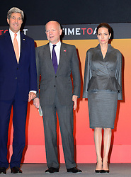 Image ©Licensed to i-Images Picture Agency. 13/06/2014. London, United Kingdom. (L-R) John F. Kerry, Secretary of State of the United States of America; William Hague, UK Secretary of State for Foreign and Commonwealth Affairs; Angelina Jolie attend Global Summit to End Sexual Violence in Conflict, Excel London Exhibition Centre. Picture by Nils Jorgensen / i-Images