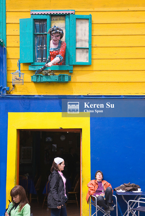 Sculpture in window of colorful house, La Boca, Buenos Aires, Argentina