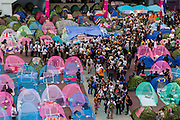 19 FEBRUARY 2014 - BANGKOK, THAILAND: Anti-government protestors line up amidst their tents in front of the National Stadium in Bangkok. Anti-government protests organized by Suthep Thaugsuban and the People's Democratic Reform Committee have gridlocked parts of Bangkok since November.    PHOTO BY JACK KURTZ
