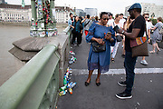 Busy scene of tourists on Westminster Bridge in London, United Kingdom. This is one of the busiest areas for tourism in the capital. As a result of increased visitor numbers, some areas of London are covered in litter and rubbish thrown away.