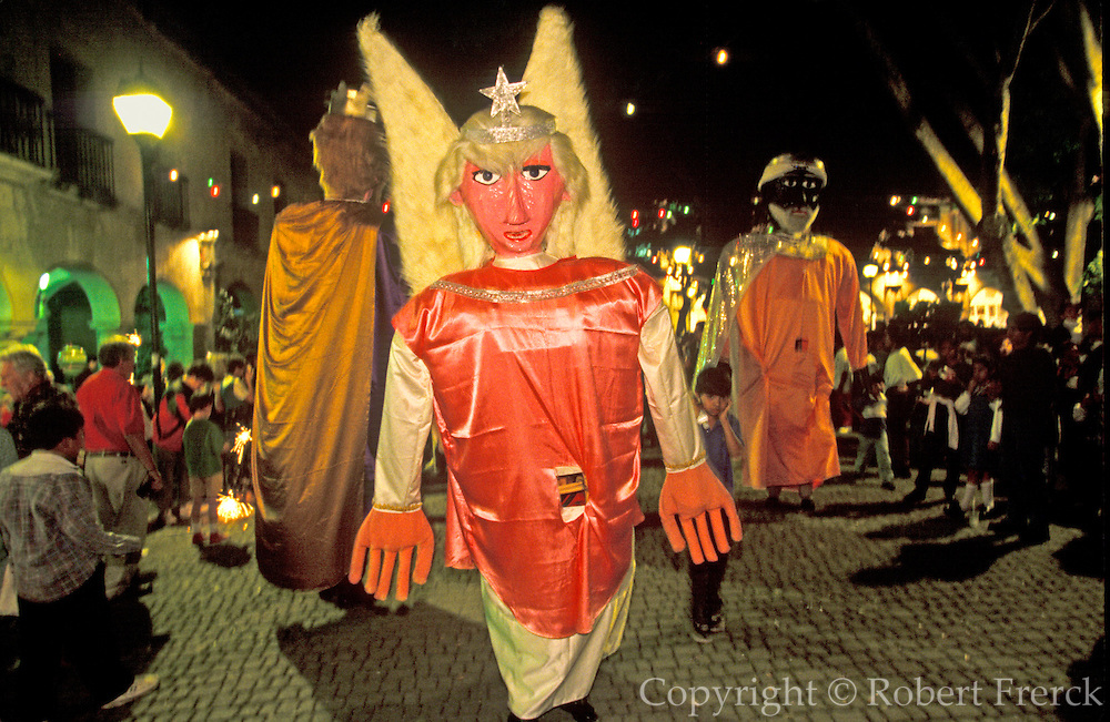 MEXICO, OAXACA STATE, FESTIVALS Oaxaca; Dec 24th, Christmas procession around the Zocalo, with floats, giant figures and costumed dancers