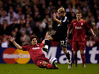 Photo: Jed Wee.<br />Liverpool v Anderlecht. UEFA Champions League.<br />01/11/2005.<br /><br />Liverpool's Xabi Alonso (L) slides in to tackle Anderlecht's Christian Wilhelmsson.