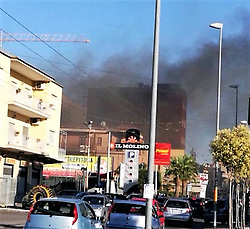 June 18, 2017 - Giugliano In Campania, Campania/Sant'Antimo, Italy - Naples - This afternoon at about 6pm there was the Il Molino shopping center between Sant'Antimo, Giugliano and Melito. The causes of the fire were still unknown, but the center has been evacuated. The fire would burst in the back and according to some testimonials, several cartons would flame. But firefighters on the scene are still shutting down and checking what really happened. (Credit Image: © Fabio Sasso/Pacific Press via ZUMA Wire)