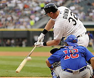 CHICAGO - JUNE 20:  Adam Dunn #32 of the Chicago White Sox swings and misses at a pitch while batting against the Chicago Cubs on June 20, 2011 at U.S. Cellular Field in Chicago, Illinois.  The Cubs defeated the White Sox 6-3.  (Photo by Ron Vesely)  Subject:  Adam Dunn
