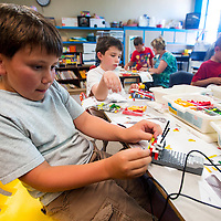 060413       Brian Leddy<br /> Jackson Fralinger assembles a robot out of Legos at Jefferson Elementary Tuesday. Fralinger was one of several students that participated in a Robotics class offered through the Kid's College at the University of New Mexico-Gallup.