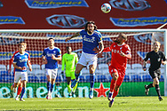 Cardiff City's Marlon Pack (21) heads clear from Nottingham Forest's Lewis Grabban (7) during the EFL Sky Bet Championship match between Cardiff City and Nottingham Forest at the Cardiff City Stadium, Cardiff, Wales on 2 April 2021.