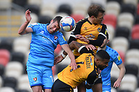 Football - 2020 / 2021 Sky Bet League Two - Newport County  vs Cheltenham Town - Rodney Parade<br /> <br /> Matty Blair of Cheltenham Town battles for possession with Mickey Demetriou and Joss Labadie of Newport County.<br /> <br /> COLORSPORT/ASHLEY WESTERN