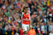 Arsenal's Alexis Sanchez celebrates after scoring his teams second goal of the game.  Barclays Premier league match, Arsenal v Manchester city at the Emirates Stadium in London on Saturday 13th Sept 2014.<br /> pic by John Patrick Fletcher, Andrew Orchard sports photography.