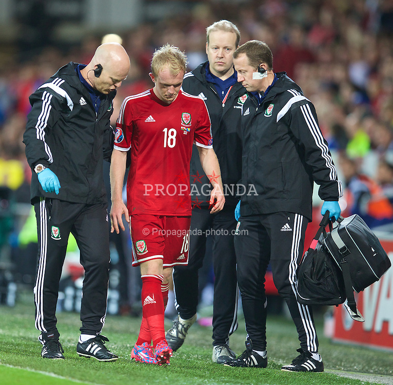 CARDIFF, WALES - Friday, October 10, 2014: Wales' Jonathan Williams with physiotherapist Sean Connelly and Medical Officer Doctor Jon Houghton during the UEFA Euro 2016 qualifying match against Bosnia and Herzegovina at the Cardiff City Stadium. (Pic by David Rawcliffe/Propaganda)