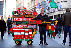 Half and half Scarves and memorabilia for sale ahead of the Autumn International match at the Principality Stadium, Cardiff.