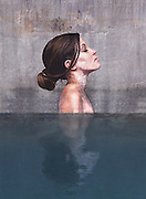Artist Paints Stunning Seaside Murals While Balancing On A Surfboard<br /> <br /> Hawaii-born painter and street artist Sean Yoro (a.k.a. Hula) has created a stunning series of street art murals depicting women emerging from the water along the concrete walls of ruined and abandoned structures. At home on the water, he paddles on a surfboard to reach the best locations for his art, even managing to balance his paint cans as well.<br /> Before the NY-based artist unveiled these stunning street art murals on his Instagram, he had already made a name for himself with his beautiful portraits of women painted on canvas and even on old surfboards.<br /> ©Sean Yoro/Exclusivepix Media