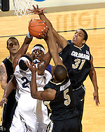 Colorado forward Jermyl Jackson-Wilson (31) blocks Kansas State forward Cartier Martin's (20) shot in the second half at Bramlage Coliseum in Manhattan, Kansas, February 10, 2007.  K-State beat Colorado 78-59.