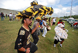 29 August 2014. Lower 9th Ward, New Orleans, Louisiana. <br /> Survivors of the storm. Ronald Favre leads a second line parade with residents, activists  and survivors in memory of those who perished in the storm 9 years ago.<br /> Photo; Charlie Varley/varleypix.com