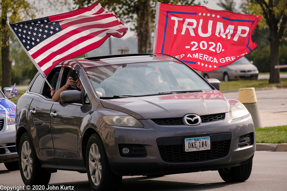 26 SEPTEMBER 2020 - DES MOINES, IOWA: A person participating in the motorcade rally supporting the reelection of President Donald J. Trump passes the Iowa State Capitol. More than 1,500 people in 500 vehicles participated in motorcade through Des Moines Saturday. They started in the suburbs south of downtown, drove through downtown, and ended at the State Capitol.      PHOTO BY JACK KURTZ