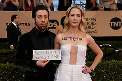 January 29, 2017 - Los Angeles, California, U.S. - The Big Bang Theory star SIMON HELBERG (L) and JOCELYN TOWNE and his wife make a statement on the red carpet at 23rd Annual Screen Actors Guild Awards at The Shrine Expo Hall. (Credit Image: © John Mccoy/Los Angeles Daily News via ZUMA Wire)