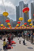People praying at Wong Tai Sin Temple, Kowloon, Hong Kong, China.