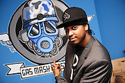 Iron Braydz, 26, is pointing to a gas mask graffiti painted on the wall of his living room in Willesden, London, on Thursday, Feb. 15, 2007. Islamic Hip Hop artists like the duo 'Blind Alphabetz', from London, feel more than ever the need to say what they think aloud. In the music industry the backlash of a disputable Western foreign policy towards Islamic countries and its people is strong. The number of artists in the European Union and the US taking this into consideration and addressing the current social and political problems within their lyrics is growing rapidly and fostering awareness for Muslim and others alike.