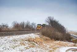 Union Pacific Locomotive 6577, an AC44CW built in 1997 pulls a line of flats through the crossing at M.P. 134.93 near Historic Route 66 during a light snow shower on January 17, 2021.