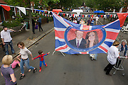Neighbours and friends in Desenfans Road, Dulwich south London, celebrate the royal wedding of Prince William and Kate Middleton (now called the Duke and Duchess of Cambridge). Across the UK, 5,500 formal road closures (825 in London) were arranged with local authorities and residents held traffic-free events, the like of which haven't been seen since the ill-fated wedding of Charles and Diana in 1981 - in the traditions of Victorian and end of war eras.