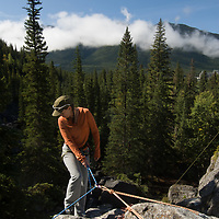 Barb Wilson starts to rappel at Rundle Rock near Banff, Alberta, in Canada's Banff National Park.