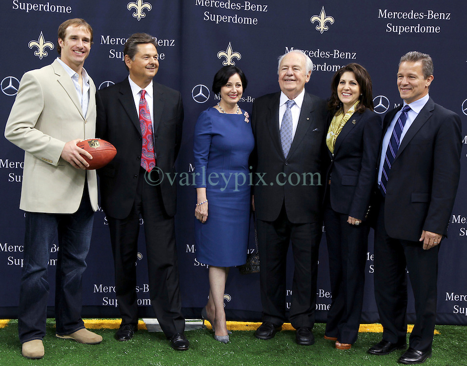 04 October 2011. New Orleans, Louisiana, USA.  <br /> NFL's New Orleans Saints announce a multi million dollar deal with Mercedes-Benz for naming rights on the Louisiana Superdome. Now the Mercedes-Benz Superdome. L/R Quarterback Drew Brees, Mercedes-Benz USA President and CEO Ernst Leib, Gayle Benson (wife of Tom), Saints owner Tom Benson, grand daughter, part owner and Saints VP Rita Benson Leblanc, and Mercedes-Benz VP Marketing Stephen Cannon.<br /> Photos; Charlie Varley/varleypix.com