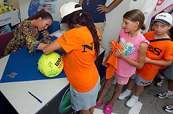 Jelena Jankovic of Serbia signs autographs for fans after she retired due to injury of her left ankle at Banka Koper Slovenia Open WTA Tour tennis tournament, on July 24, 2010 in Portoroz / Portorose, Slovenia. (Photo by Vid Ponikvar / Sportida)