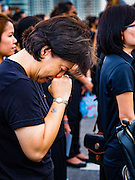 05 DECEMBER 2016 - BANGKOK, THAILAND: A woman weeps on Bhumibol Bridge during a ceremony honoring the late King of Thailand. Tens of thousands of Thais gathered on Bhumibol Bridge in Bangkok Monday to mourn the death of Bhumibol Adulyadej, the Late King of Thailand. The King died on Oct 13 after a lengthy hospitalization. December 5 is his birthday and a national holiday in Thailand. The bridge is named after the late King, who authorized its construction. 999 Buddhist monks participated in a special merit making ceremony on the bridge.       PHOTO BY JACK KURTZ